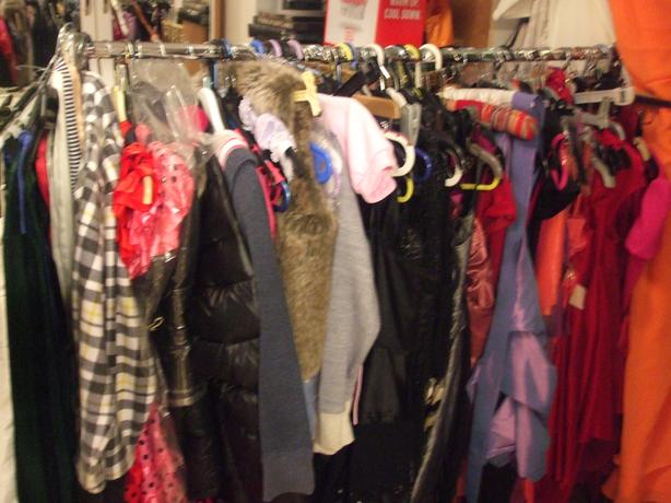 2 racks of mostly new clothing most with tickets on all sizes