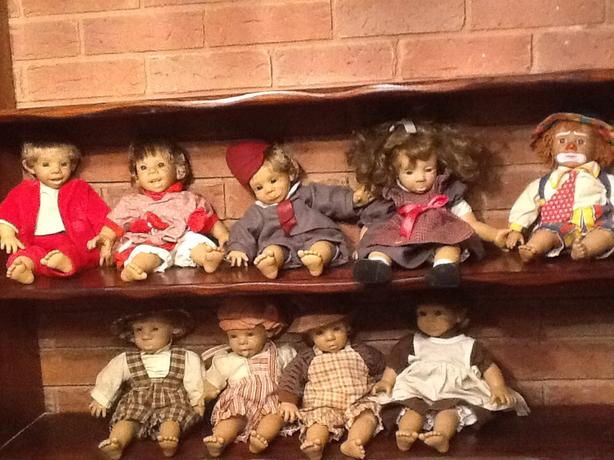 9 collectible dolls