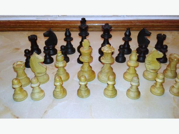 set of small wooden chess pieces