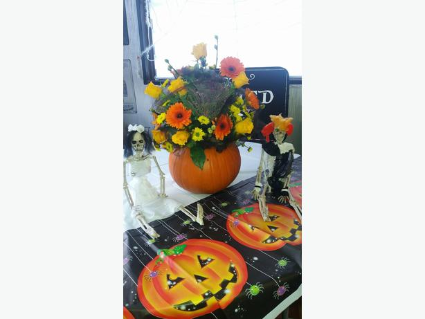 Halloween pumpkin flower arrangement