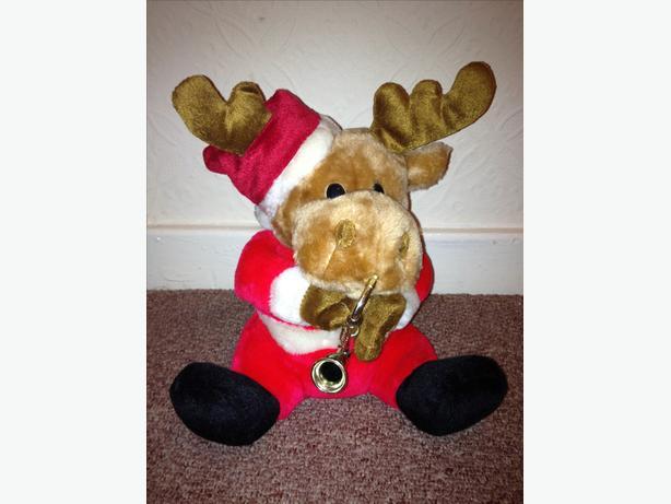 Christmas musical reindeer playing saxophone
