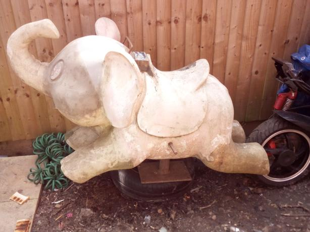 antique old fair ground ride elephant