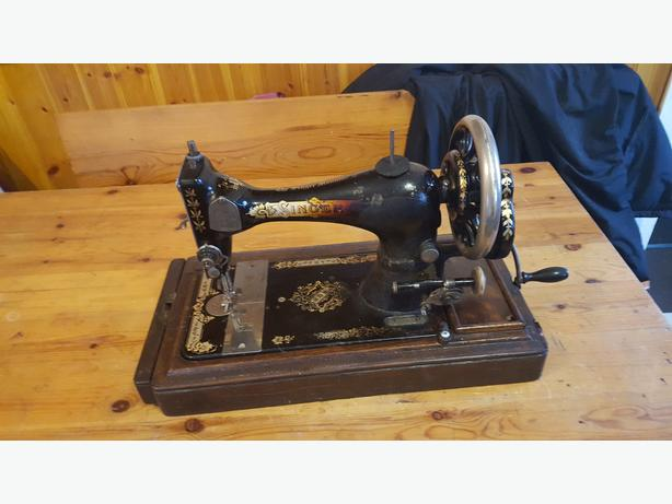 singer sewing machine im open to offers