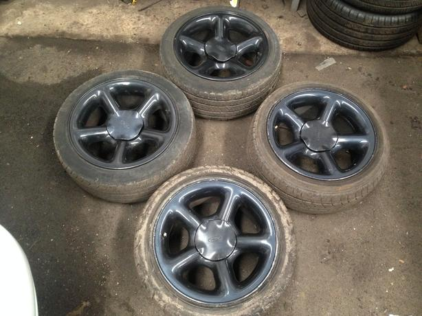 "Genuine escort cosworth alloy wheels 16"" x4 with centre caps rare"