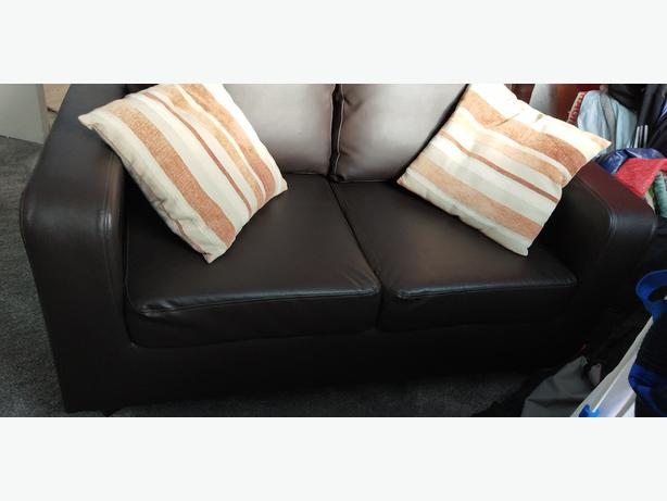 Dark brown faux leather like sofa settee 2 seater with cushions