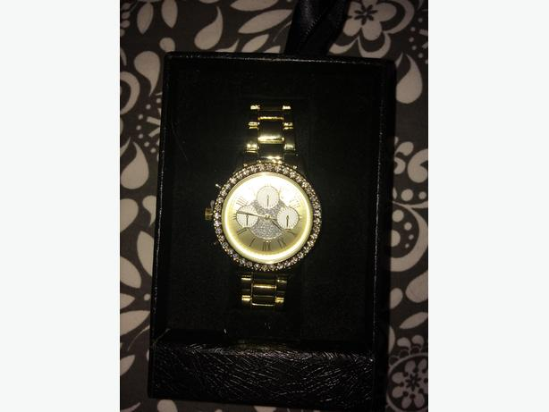 women's gold and crystal watch