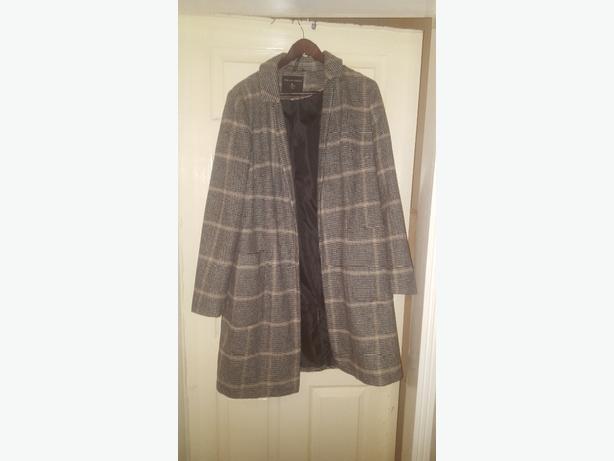 size 16 coat never worn