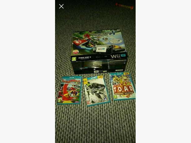 wii u console with 4 games