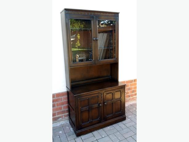 Solid oak Ercol \ Old Charm style bookcase with glass doors.