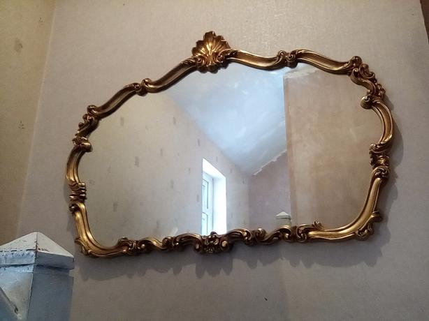 large gilt edged mirror