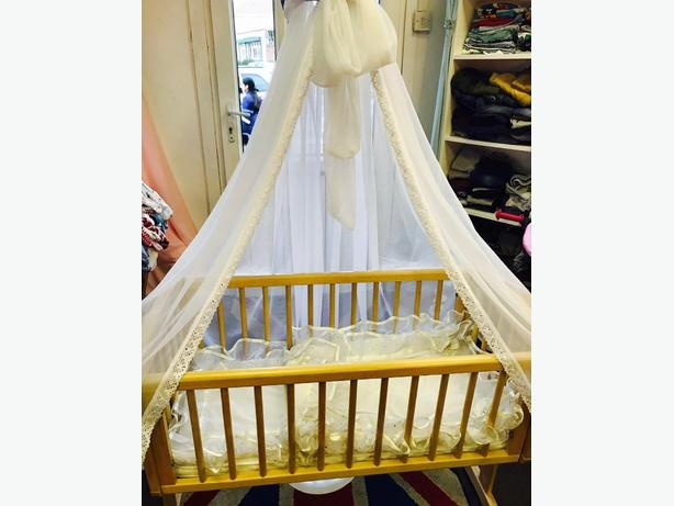 Beautiful swinging crib with drapes and stand