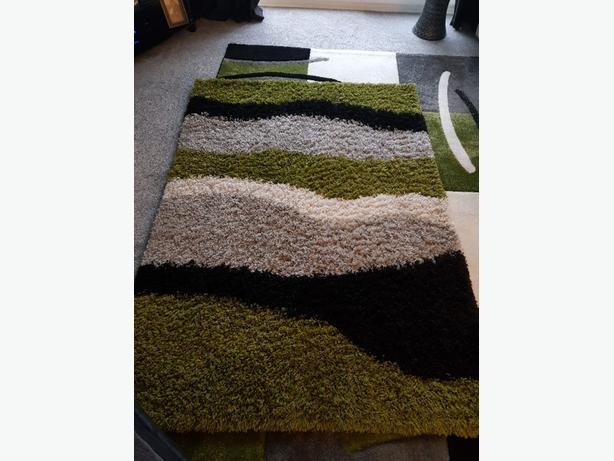 green and black rug