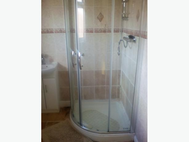 Used quadrant shower