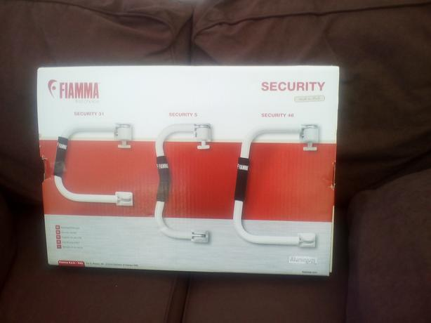 Security arm for caravan or m/home.