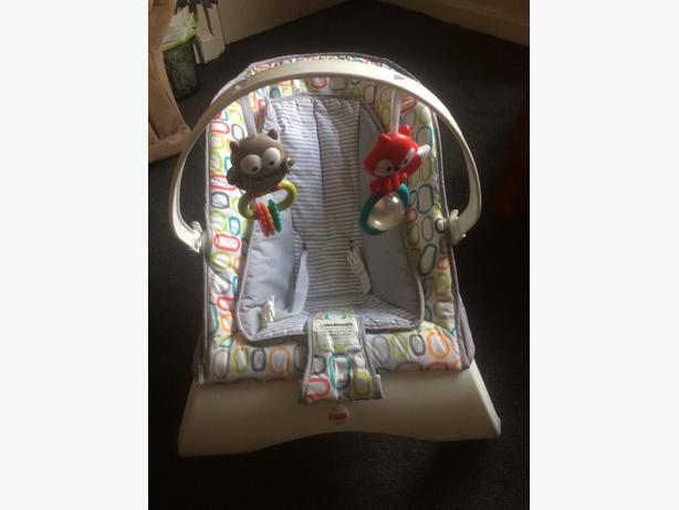 moses basket. baby bouncer and baby carrier.
