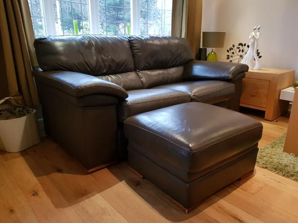 2 Brown Leather sofas and matching footstool