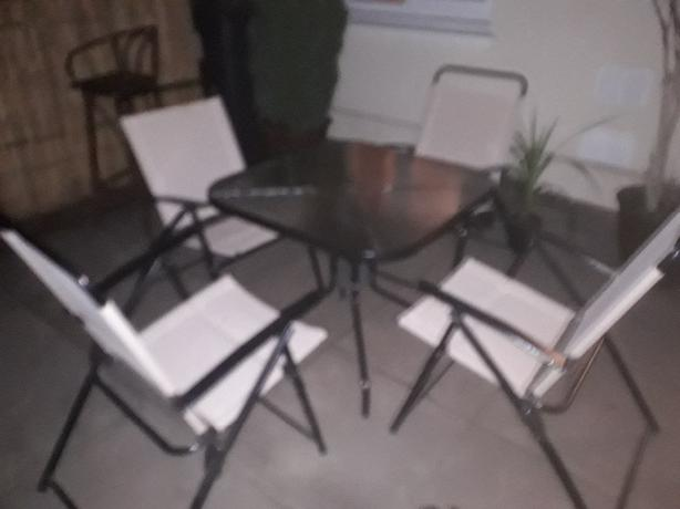Glass garden table and 4 chairs.