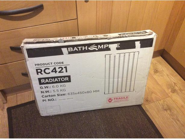 New in box radiator white