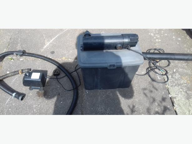 pond pump and filter box with uv light and pipe fitting