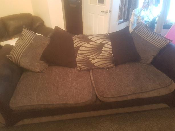 4 seater black and grey sofa.