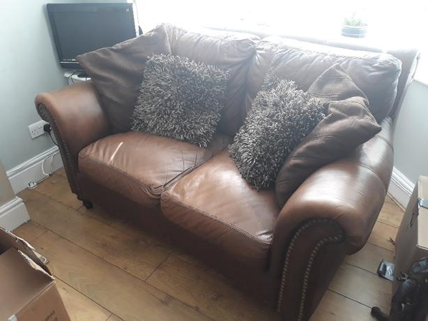 2 brown leather sofas