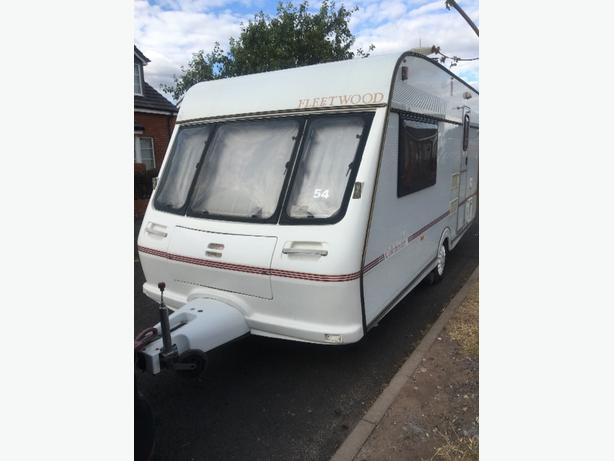 2 BERTH FLEETWOOD CARAVAN WITH MOTOR MOVER, AWNING AND EXTRAS