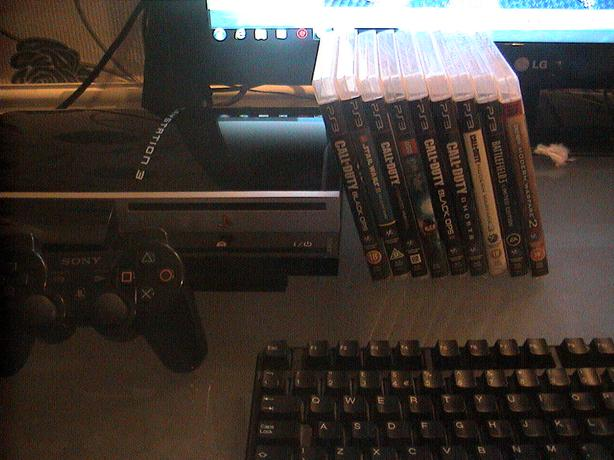 ps3 80gb mint condition little use nice and quite + games and sony sixaxis pad