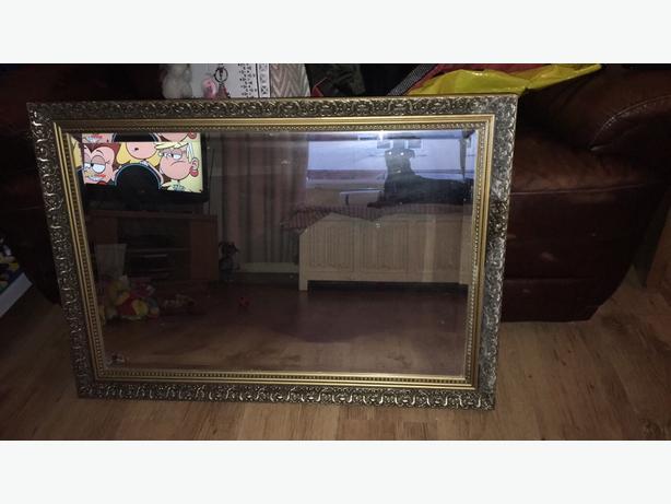 huge heavy gold framed mirror