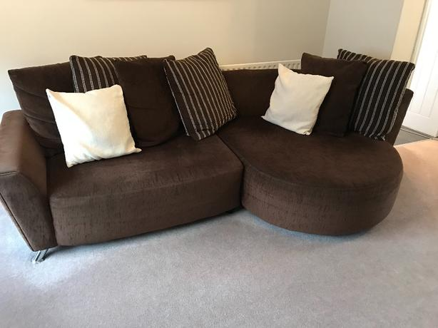 Brown fabric sofa, chair and footstool