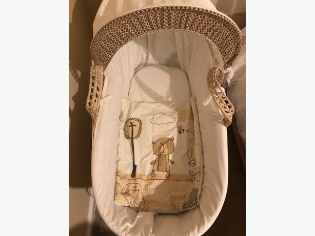 cream and white moses basket