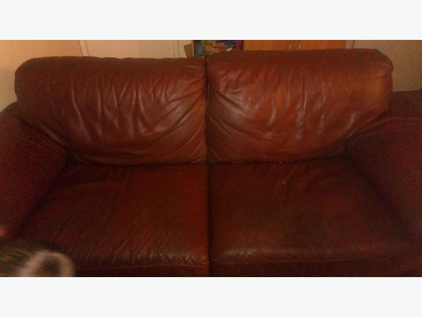 FREE:   brown leather sofa