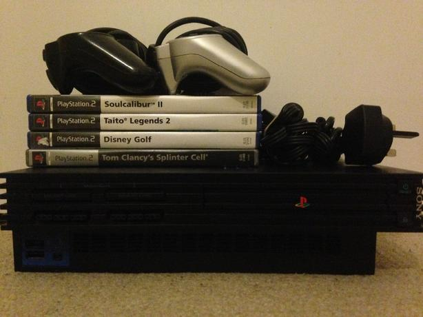 PS2 console + games and controllers
