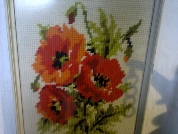 vintage embroided picture of poppies