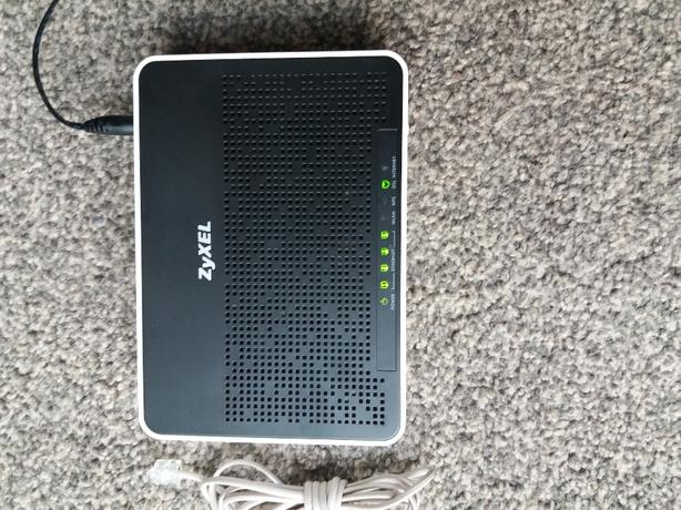 ZyXEL AMG1302-T10B Wireless Router