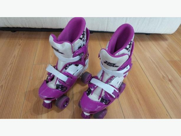 CHILD'S ADJUSTABLE QUAD SKATES SIZE 1- 4