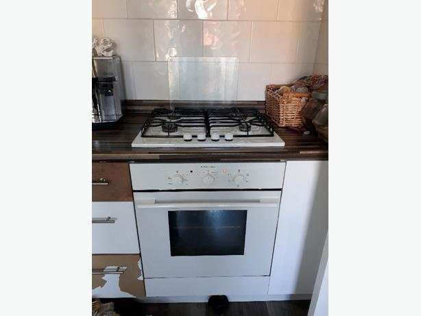white hob and oven with extractor fan