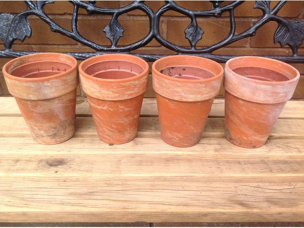 QUARTET OF TERRACOTTA GARDEN PLANT POTS
