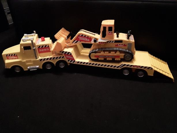 large tonka truck trailer and digger