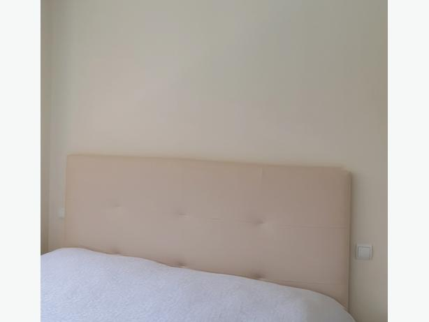 Nearly new leatherette headboard for king size bed.