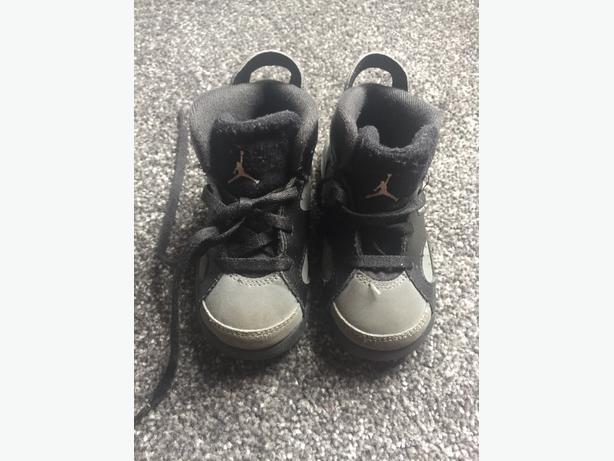 Black and grey Jordans