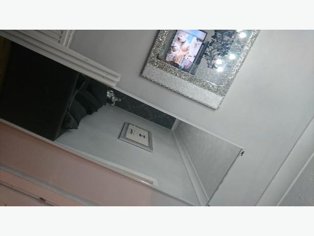 Sliding mirror doors