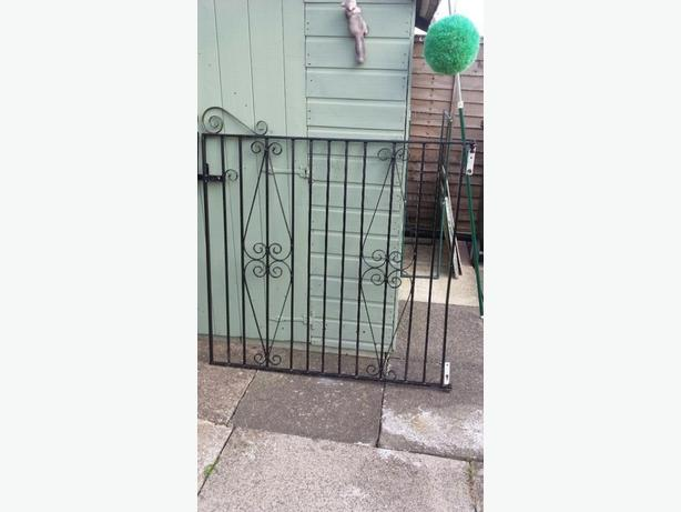 pair of metal driveway gates with fittings
