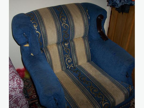 Sofa. Has wood pieces missing from armrests