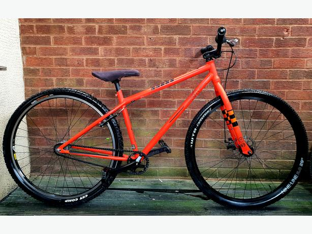 "Commencal uptown bike, 29""wheels,orange & black"