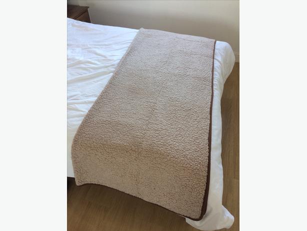 Large beige light brown sheep wool blanket throw