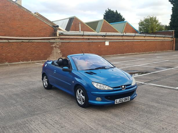 Automatic 206cc convertable 1.6 drives great, long mot, low mieage