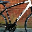 Carrera Crossfire bike,21 speed,700c wheels,front suspension