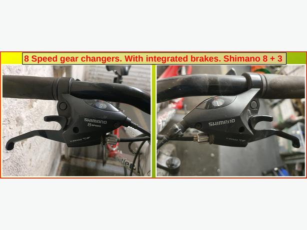 8 speed gear changers. With integrated brake levers.