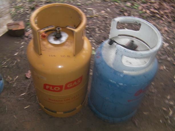 Three empty gas bottles