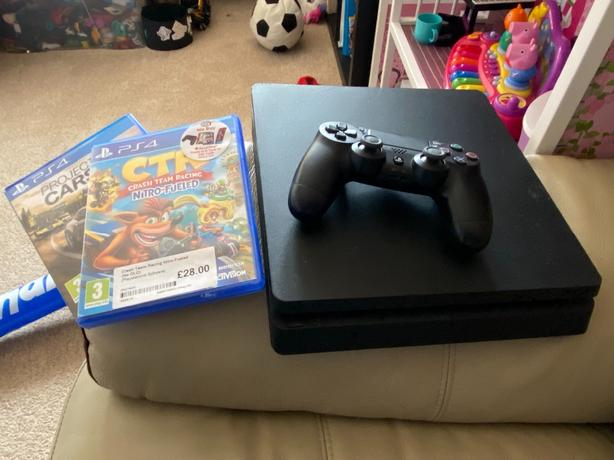 Used PS4 for sale with controller + brand new unused steering wheel